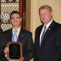 Chris Bollinger, Executive VP of Bollinger Shipyards, Inc., (center) accepts the 2102 Award for Excellence in Safety from SCA Manager Government Affairs, Ian Bennitt (left), and SCA President, Matthew Paxton.
