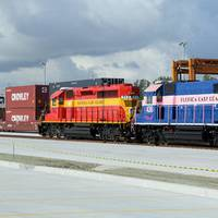 Crowley containers aboard the FEC Train during the recent opening ceremony of the new intermodal container transfer facility adjacent to Crowley's Port Evergaldes terminal. (Photo courtesy of Crowley)