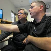 Eric Larsson and Stephen Polk working together at SCI's Center for Maritime Education in Houston, TX. Photo courtesy SCI