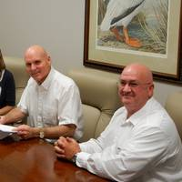 """Erika Hamrick, Cat Marine Regional Sales Manager Americas (left), officially recognizes Robert """"Bobby"""" Webb, CEO at Louisiana Cat, as the first Cat Propulsion Dealer in the Americas (center). Also pictured is Mike Jennings, General Manager (right). (Photo: Louisiana Cat)"""
