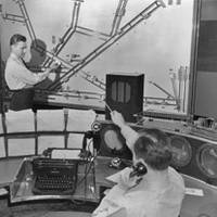 Air traffic controllers plot the positions of aircraft on a wall-mounted display, circa 1950. Will control of ships at sea evolve as did air traffic control?
