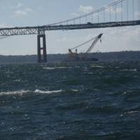 Donjon's Chesapeake 1,000 heavy lift crane works to salvage a sunken barge under the Newport Pell Bridge in Newport, Rhode Island last November.