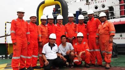 Survivor With Rescuers: Photo credit Swiber Holdings