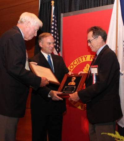 American Society of Naval Engineers (ASNE) President Ronald Kiss (left) and U.S. Rep. Randy Forbes (Va.) present the Frank C. Jones Award to Bill Clifford (right), president of BAE Systems Ship Repair, at the Fleet Maintenance and Modernization Symposium in Virginia Beach. The award, presented annually by the ASNE, recognizes leaders in naval engineering who have contributed to ship maintenance and alteration programs for naval vessels.