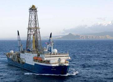 UH Professor Jonathan Snow will embark on a two-month journey aboard the JOIDES Resolution research vessel. Pictured here, the ship is shown departing Honolulu in 2009 for a prior expedition. (Credit: William Crawford, IODP/TAMU)