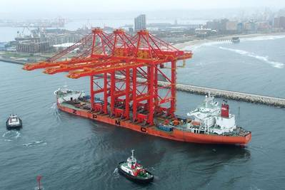 Three mega-sized harbour cranes arriving in the Port of Durban onboard the Zhen Hua 27 vessel.  Photo by Roy Reed
