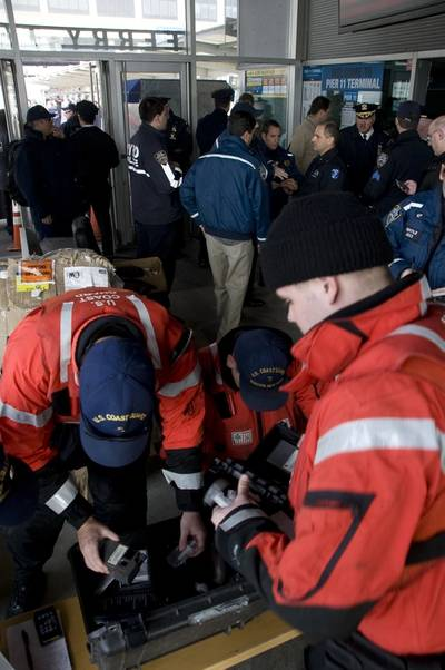 NEW YORK – Coast Guard law enforcement officers, from Station New York, prepare to help administer drug and alcohol tests to the crew of the Seastreak ferry at Pier 11, Manhattan, Jan. 9, 2013.