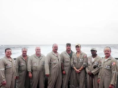 left to right: Alan Williams, AB; Doug Carson, third mate; Pat McGee, cook; Ron Robinson, chief mate; Chris Farmer, AB/tankerman; Vince Mull, chief engineer; Travis Stringer, AB/tankerman, and  Gus Cramer, captain.