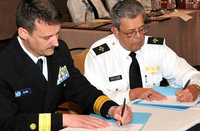 Signing the Agreement: Photo credit NOAA