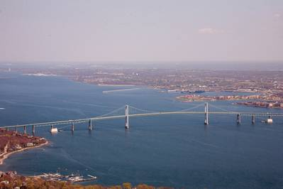 Aerial view of Narragansett Bay with the Claiborne Pell Bridge, known as the Newport Bridge, in the foreground. Naval Station Newport is to the north right of the bridge.