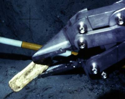 Manipulating recovery of a gold bar: Image courtesy of Odyssey Marine Exploration
