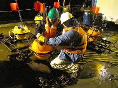 Preparation of Ocean-bottom Seismometer: Photo credit USCG