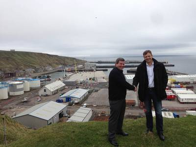 Shaking hands on a trailblazing agreement – Hugh Simpson, left, and Knut Magne Johannessen at Scrabster Harbour