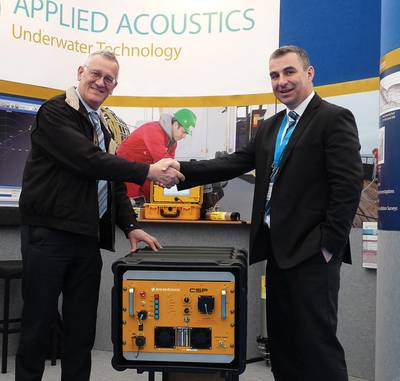 Tom Nicols of Geomatrix left, receiving his new seismic power supply, from Applied Acoustics' Gavin Willoughby.