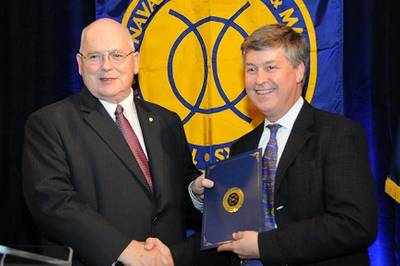 SNAME President Peter Noble presents ACMA President Scott McClure with his SNAME Fellow's Certificate