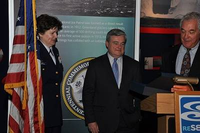 Dr. Coan, President and Chief Executive Officer of the Sea Research Foundation, presents a plaque commemorating the centennial of the International Ice Patrol to CDR Lisa Mack, Commander of the International Ice Patrol, at the official opening of the Ice Patrol gallery at the Mystic Aquarium.