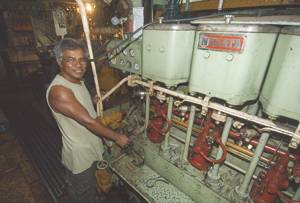 Chief Engineer Bonillo Rafugio with the cam-shaft control on the venerable Nigata.