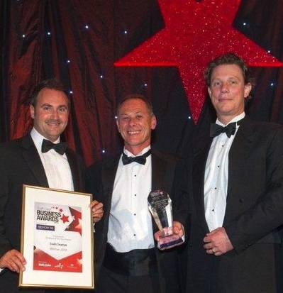 Saab Seaeye directors receive the two awards: Business of the Year and Excellence Through Innovation. Left to right, Mark Exeter, Operations Director; Matt Bates, Sales Director; Jon Robertson, Managing Director.