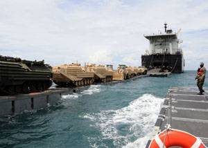Military Sealift Command Maritime Prepositioning Ship USNS 1st Lt. Baldomero Lopez conducts an at-sea offload of Marine Corps cargo off the coast of Thailand May 2. The operation, which began April 28 and ended May 8, delivered cargo for the 3rd Marine Expeditionary Force, which will participate in Cobra Gold – an annual exercise designed to promote regional stability and security throughout Southeast Asia. A second MSC Maritime Prepositioning ship, USNS 1st Lt. Harry L. Martin, also participat