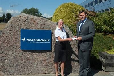 Dr. Antoni Mazur, Managing Director handing over the check for the donation from Atlas Elektronik UK to Sam West, Marketing Manager