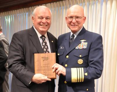 2012 photo of US Coast Guard Commandant Robert J. Papp, Jr. presenting AdvanFort President William H. Watson a plaque for service to the Amver program and Amver Logo