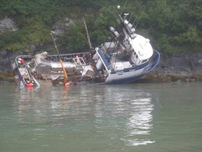 Coast Guard personnel monitor the 65-foot fishing tender, Fate Hunter, after it grounded near Shoup Bay, approximately four miles west of Valdez, Alaska, Aug. 11, 2013. (U.S. Coast Guard photo by Marine Safety Unit Valdez)