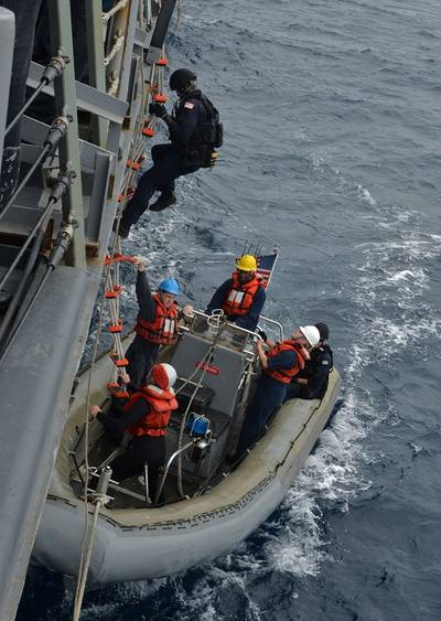 Sailors assigned to the U.S. Coast Guard Law Enforcement Detachment Team 101 embark onto a rigid-hull inflatable boat during small boat operations aboard the guided-missile frigate USS Gary (FFG 51). Joint interagency and international relationships strengthen U.S. Third Fleet's ability to respond to crises and protect the collective maritime interests of the U.S. and its allies and partners. (U.S. Navy photo by Mass Communication Specialist 2nd Class Derek Stroop)