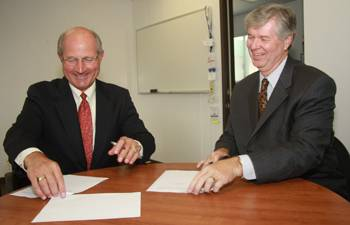 On left, President William B. Eisenhardt of Cal Maritime with Billy Owen, Clear Port Vice President.