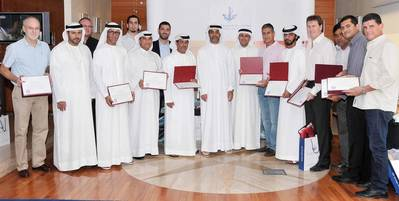 Amer Ali, Executive Director, Dubai Maritime City Authority, among marine driver's license holders with senior officials in DMCA during the ceremony at DMCA headquarters.