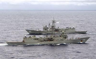 HMAS Newcastle and HMAS Melbourne pass each other as Melbourne takes over from Newcastle as the Australian ship assigned to Operation SLIPPER. (Credit: LA Richard Close)