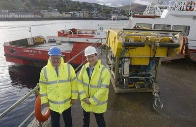 Energy Minister, Fergus Ewing (left), is pictured in front of one of The Underwater Centre's new vessels and work-class ROV, with the Center's General Manager, Steve Ham.