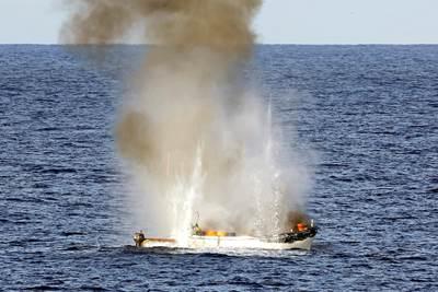 Pirate skiff destroyed: Photo credit ABIS Jayson Tufrey, Commonwealth of Australia