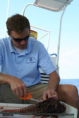 Dr. James Morris & Lionfish: Photo credit NOAA
