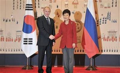 Putin & Park shake hands: Photo courtesy of the Russian Federation