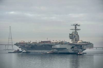 The aircraft carrier Gerald R. Ford (CVN 78) was moved Sunday to Newport News Shipbuilding's Pier 3, where it will undergo additional outfitting and testing for the next 28 months. Photo by Chris Oxley