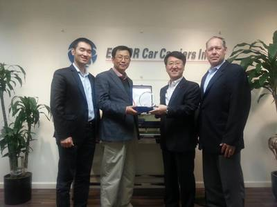 Capt. S.C. Kim, ISS Port Captain for Korean Customers, receiving the award for 'Best in Vessel Operation' from Mr. Sang Kim, Director of EUKOR and Head of EUKOR America.