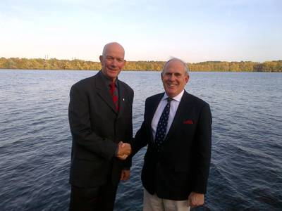 Graham Ford (left), President of the ILS and Michael Vlasto, Chairman of the IMRF (right) shake hands on their agreement.