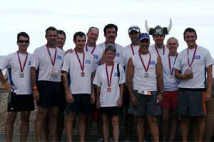 Team W&O at the completion of the race: Art Parrish, Jack Guidry, Mike Page, Collin Luke, Carl Herman, Peter Osterman (back), Sandy White (in front of Peter), Steve Stafford, Alex Piquer, Kyle Posey (in horns), Lisa Collins, Rogier Blokdijk.