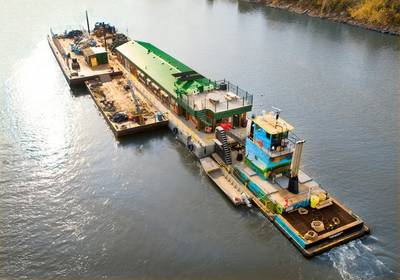 """The M/V River Cleanup II pushes Living Land & Waters' floating classroom """"Teamwork"""" en route to New Orleans."""