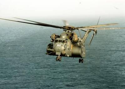 An MH-53E Sea Dragon assigned to Helicopter Mine Countermeasures Squadron 15, launches from the amphibious assault ship USS Peleliu. Peleliu is the flagship for the Peleliu Strike Group and is deployed to the U.S. 5th Fleet area of responsibility to conduct maritime security operations. (A stock photo of a MH-53E Sea Dragon helicopter taken in 2008.)