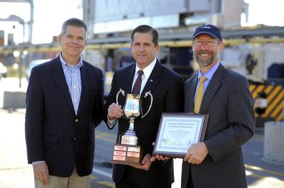 Christopher Grundler, left, director, office of transportation and air quality for the U.S. Environmental Protection Agency and Stan Meiburg, right, acting regional administrator for the EPA's Southeast Region, present Georgia Ports Authority Executive Director Curtis Foltz, center, an award for environmental stewardship at the GPA Garden City Terminal. (GPA Photo/Stephen Morton)