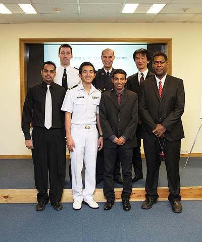From left to right, back row: Nikolay Radoslavov Lyaskovski (Bulgaria); Mohamed Zabour (Algeria) and Yusuke Nagase (Japan). Front row: Dwight Nanan (Trinidad & Tobago); Sub Lt Uaychai Phothong (Thailand); Rahubadda Kankanamge Anura Ariyarathna (Sri Lanka) and John Dalomae (Solomon Islands).