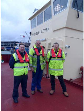 Wearing the new K2- 275 twin chamber lifejackets (left-right): Andy Bracewell –  Sales Manager, Mr Robert Gray – Managing Director at Southampton Marine Services , Andy Norwood – Health and Safety Officer, Svitzer, UK