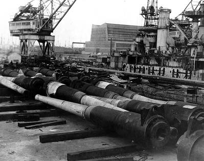 Ship being dismantled in the backround is USS South Carolina (BB-26) (U.S. Naval Historical Center. Courtesy of the San Francisco Maritime Museum, San Francisco, California)