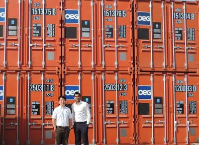 Daniel Lim and Sahil Gandhi (L to R) in front of a line of OEG Containers