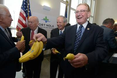 Port of New Orleans President and CEO Gary LaGrange hands out Chiquita Bananas following the brand's announcement to return its shipping operations to the Port of New Orleans . Pictured from left are Joe Accardo, Executive Director of the Ports Association of Louisiana, Port Commissioners Robert Barkerding, Jr. and Michael Kearney, and LaGrange.