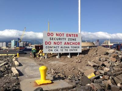 The new sign in Honolulu Harbor will inform mariners of the 24/7 security zone in the harbor and whom to contact for permission to enter. (U.S. Coast Guard photo)