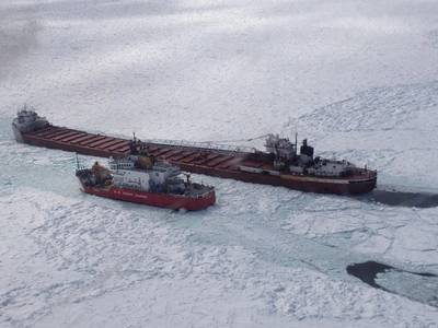 The crew of Coast Guard Cutter Mackinaw, homeported in Cheboygan, Mich., conducts an escort on Lake Superior near Whitefish Point April 3, 2014. (USCG photo)