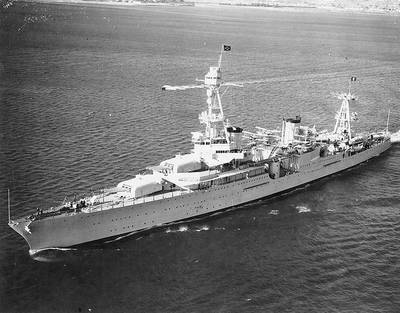USS Houston (CA-30) with President Franklin D. Roosevelt on board. She is flying an admiral's four-star flag at her foremast peak, and the Presidential flag at her mainmast peak. (U.S. Naval Historical Center Photograph)
