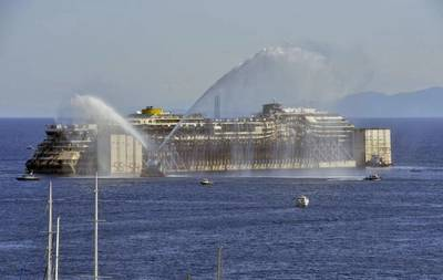 The Costa Concordia wreck is expected to reach Genoa Saturday (Photo courtesy of Titan Salvage)
